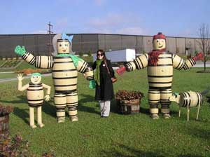 The barrel people welcome visitors to Heaven Hill Distillery.