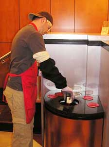 Dipping a bottle into the famous red wax at Maker's Mark