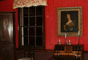 Annie's bedroom, with an image on the armoire - photo courtesy of ReggaeShow.com