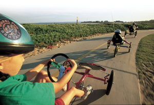 Biking on the path next to the beach. Photo courtesy of Surf City USA.