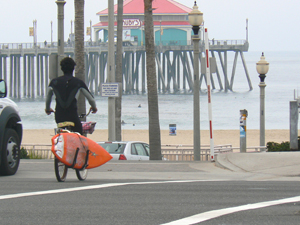 Biking with the board to the beach.