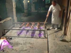 Piglets roasting on a rotisserie in Sardinia