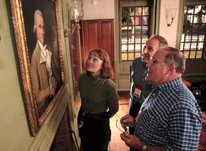 Visitors admire one of the many works of colonial art at Historic Deerfield