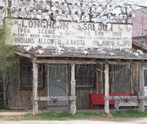 "The Longhorn Saloon is open every August when a Motorcycle Rally rides through the Reservation. The original sign read ""No Indians Allowed."" The ""No"" was recently painted over."