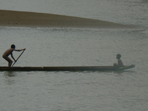 Boys in a dugout canoe, the preferred method of transport on the Pacific coast of Colombia.