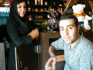 Elham and his sister at their cafe