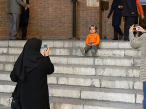 Proud parents take photos in Tehran.