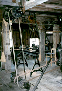 The various machines in the machine shop were operated by a series of belts, that were connected to a water turbine, which was their source of power.