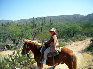 """82-year-old Zosima tries riding horses. """"Faster than the water buffalo I rode in the Phillipines in my youth!"""" she said."""