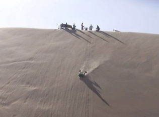 Dune Surfing Peru Flying down a dune on your stomach is the ultimate thrill ride.