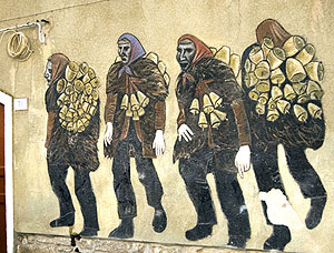 A painting of the Mamuthones on the wall of a house in Mamoiado