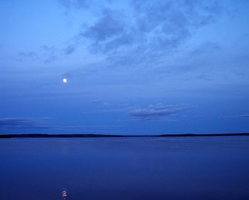 The moon rising over Steamboat Bay on Leech Lake