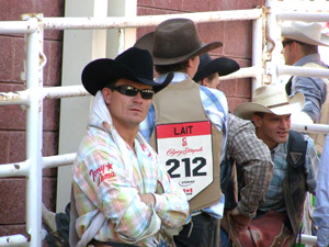Cowboys wait their turns for the next event at the Stampede.