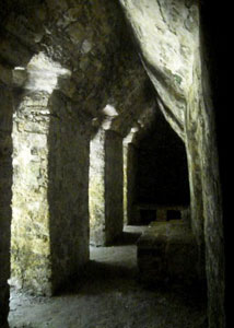 The stone benches beneath the southwest portico of Edifice 19 may actually have been beds.