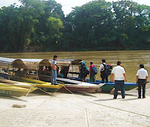At Frontera Corozal, embarcaderos (boatmen) herd tourists onto colorful wooden lanchas for the trip down river. These boats are equipped with outboard motors and can carry up to ten people at a time.