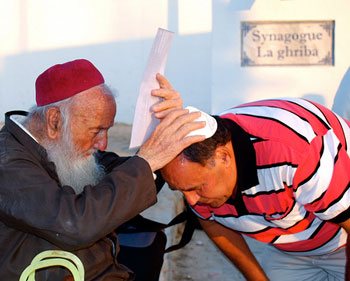Receiving a blessing at the El Ghriba Festival on the island of Djerba in Tunisia