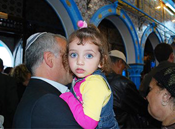 A little girlg at her first El Ghriba Festival