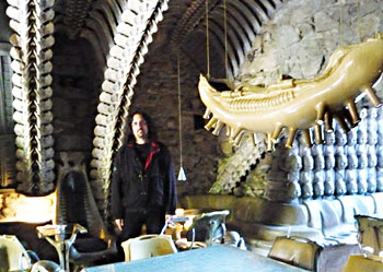 Inside the Giger Bar, with concrete vertebrae ceilings and dead babies on the wall