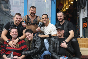 Locals celebrating Leather Weekend outside of a Commercial Street leather shop in Provincetown, Massachusetts