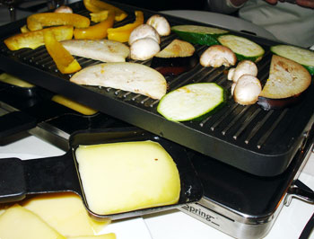 A smorgasbord of Raclette Cheese on top of Uetliberg Mountain