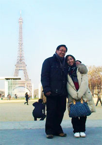 Irene Lim and her husband in front of the Eiffel Tower in Paris - a destination she wanted to see before having another child