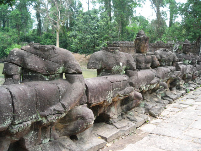The entrance to Angkor Thom, where Hindu gods struggle in a tug-of-war with spirits from the other world