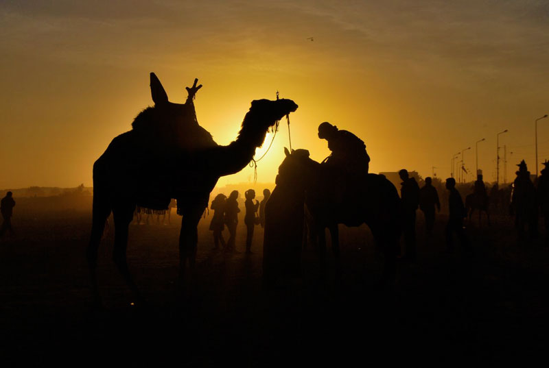 A setting desert sun at the culmination of a four-day festival