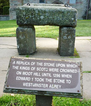 A replica of hThe Stone of Scone on Moot Hill