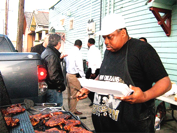 Bingo tends the grill outside the Bullets Sports Bar in New Orleans. Photos by Ann Banks.
