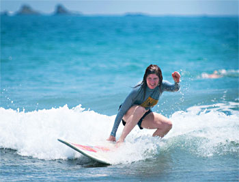 After a few shaky rides, Molly gets the hang of surfing. Photos by Ben Barnhart.