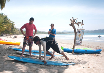 Showing the techniques on the beach.