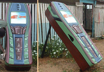 Cellphone coffin. I am still trying to figure out why someone would want to be buried in this.