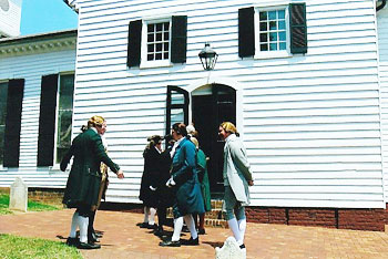 After an emotional performance, colonial actors take a break at St. John's Church. Photos by Ginger Warder.