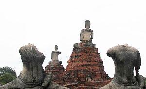 Buddha statues in various states of disrepair at Wat Phra Mahathat