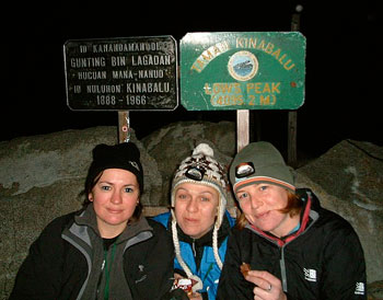 At the summit, Michelle (far right) munches on chocolate as a reward for reaching Low's Peak.