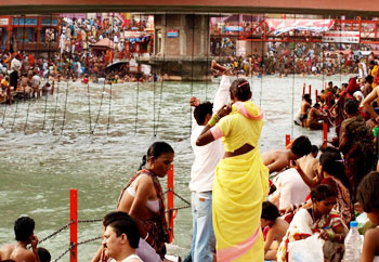 Bathing in the river at the huge gathering.