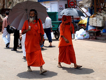 Sadhus use parasols to keep out of the sun.