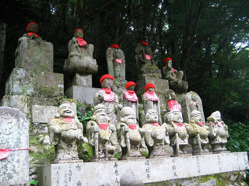 Statues along the trail to the summit of Mt. Takao in Tokyo, Japan.