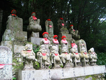 Statues along the trail. Local people take care of the statues and protect them from the elements by putting hats and bibs on them. The seven figures at the bottom are the seven deities of good luck.