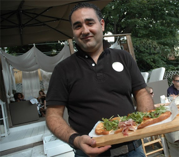 Puro Cafe owner Rashid Hassouni with the restaurant's signature flatbread