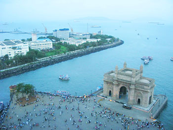 The Gateway of India provides a solid historical marker, built in 1911 as a symbol of the British Empire to those arriving by boat.