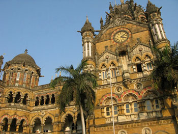The Royal Palms from Cuba flank the clocktower at Chhatrapati Shivaji Terminus, formerly Victoria Terminus.