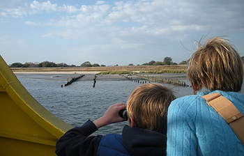 Mother and son use their binoculars looking out onto Jamaica Bay's Wildlife Refuge