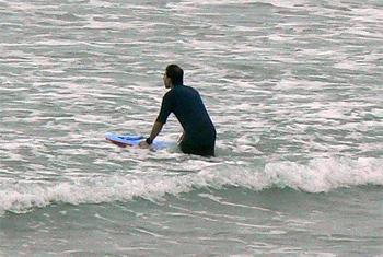 Surfer in Lorne, Victoria, Australia.