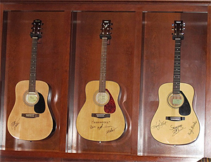 Guitars of the famous line the walls at Swamper's Bar in Muscle Shoals, Alabama
