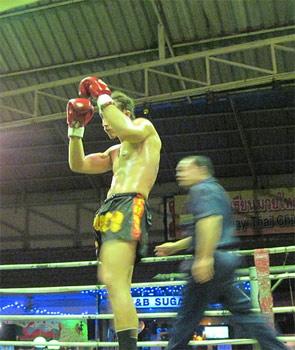 Thai boxing action.