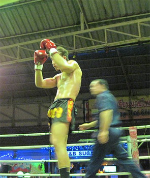 Thai boxing action.