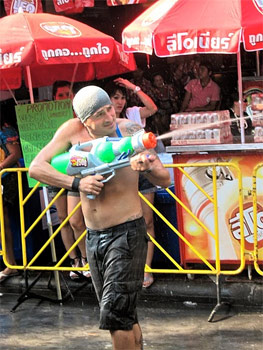 Watergunner at the Songkran Festival in Bangkok. photo by Jean Spoljaric.