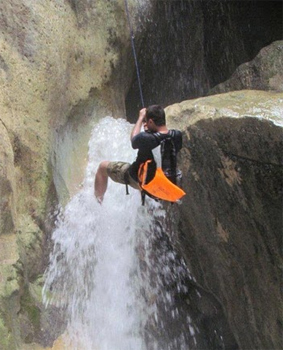 Scaling a waterfall in Wadi Mujid, Jordan.