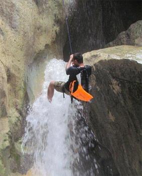 Scaling a waterfall in Wadi Mujid, Jordan.